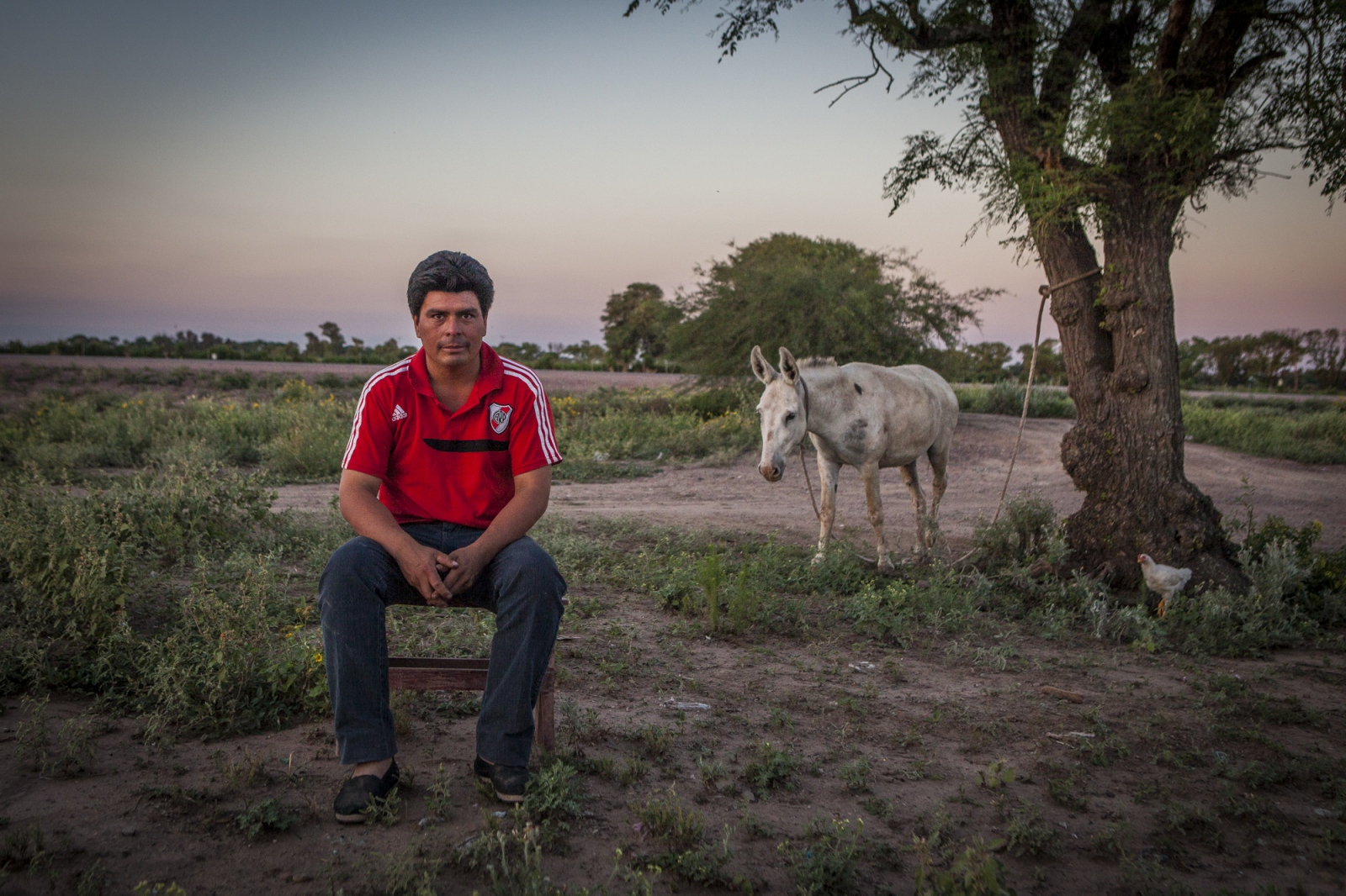 Santo Ramón Gonzales (35), sits on his backyard. He complains that soy producers are doing everything they can to expel his community out of their land. He says they use many different tactics like: pulverize their homes, fields and animals with glyphosate, threatening them with weapons and even claim with fake paperwork that they own the land. The indigenous people in the area are being threaten by soy producers that see their land as an opportunity to grow more of the crop. On the otherhand indigenous defend a sustainable agriculture and to live in harmony with the nature.