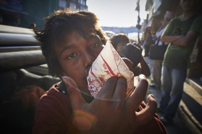 Milan Pandey (14), said that he has been sniffing glue for 9 years and that it helps him forget about his hunger.
