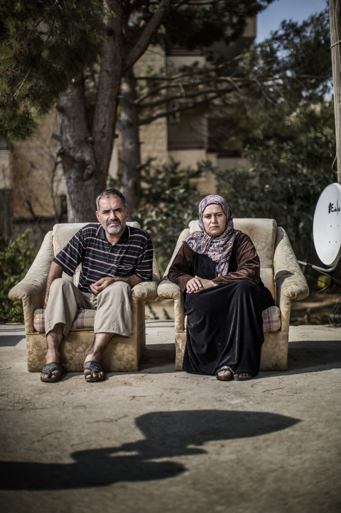 2015-09-01 Beqaa valley, Lebanon. Namn: Fatma Shdad with her husband Ali Age: 39 Profession: Housewife Hemort: Asal al-Ward, Syria En route to: Europe For how long have you been traveling and what route? -I fled two years ago with my husband and two children. Four months ago came to the refugee camp in Arsal on the border and we fled her to the Beqaa valley . 2. Tell us about your situation. -We don't live, we can't afford anything. I don't want to live this life. day passes without getting any real food to eat and I suffer when I see my paralyzed daughter cry. 3. What do you need right now? -We need a small sum of money, just a small sum so we can get new passports and airplane tickets so we can go to Turkey. From there we can go to Europe. A small sum can save our lives and future.