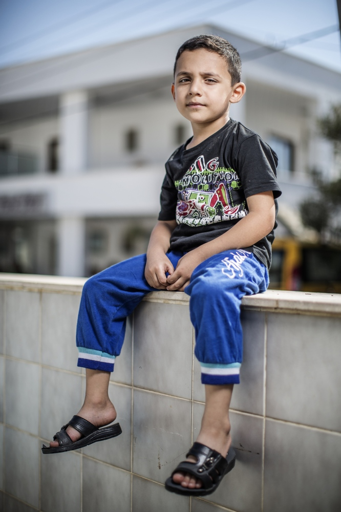 Name: Zein al-Houssein Age: 5 Profession: Child From: Hamah, Syria Traveling to: Sweden 1. For how long have you been traveling and what route? - One week with my father and brother. 2. Tell us about your situation. -I miss my friends. 3. What do you need right now? -I need to live as other children and play football.