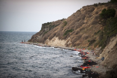 Just a stones throw from Mytilini Airport on the Island of Lesbos, Greece and with the coastline of western Turkey in full view. You can find all the evidence of migrants coming ashore. The coast line lays littered with rubber rings and pseudo life jackets used by desperate peoples fleeing war and persecution.