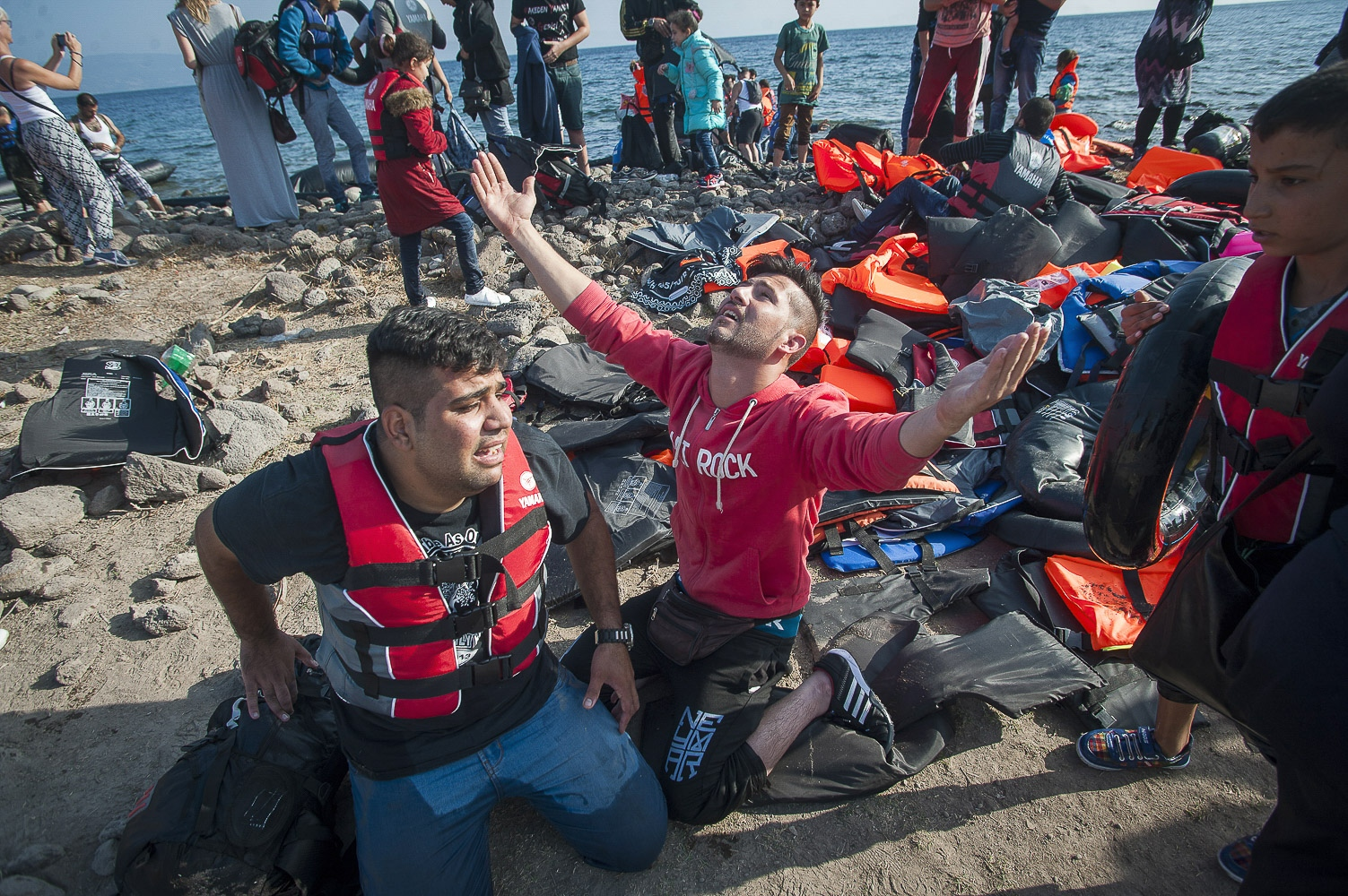 22 year old Hassat Abdul Haman from Aleppo, Syria, expresses his gratitude on his safe arrival at Limantziki beach near Mithimna, Lesbos, Greece, after crossing the Aegean Sea from Western Turkey in a rubber dinghy.