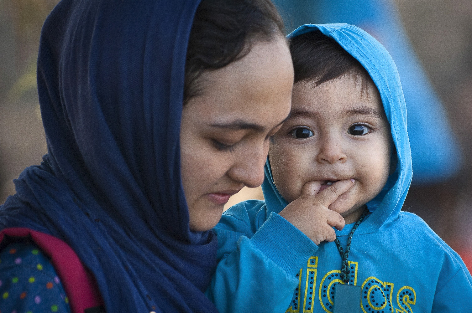 An Afghan woman with her child after their safe arrival near Molivos, Greece.