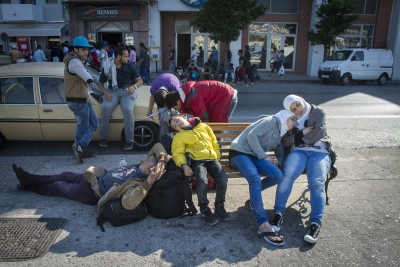 Exhausted refugees sleep at Mytilini Port harbour. Thousands of new refugees are still arriving daily from Turkey.