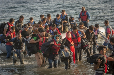 Refugees arrive by boat from the western coast of Turkey at Limantziki beach, Eftalou,near Molivos, Greece. They are met by a small but dedicated group of volunteer aid workers, who distribute water and arrange transport if possible for the extra 40 kilometers to Moria or KaraTepe Registration camp. Transport facilities are patchy at best.