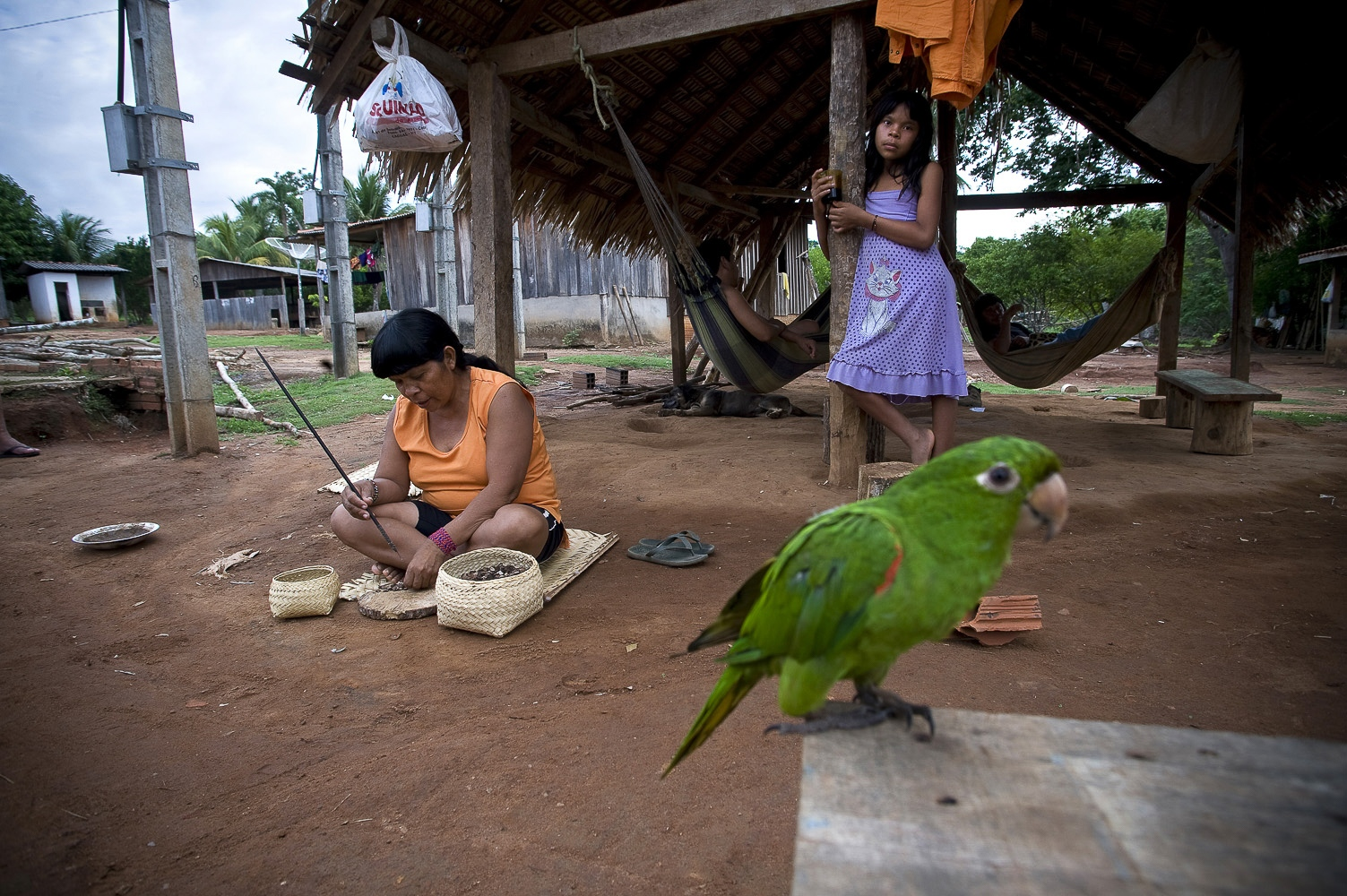 "Village life. Making beads at Lapetanha, Rondonia, Brazil at the ""7th September Indian Reserve""."