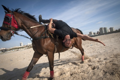 The Horsemen of Gaza. Abdulla practices his tricks on the beach front in the Gaza Strip, occupied Palestinian territory.