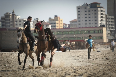 21 year old Abdulla al Ghefari and Siraj practice new tricks on the beach in Gaza, Gaza Strip, occupied Palestinian territory.