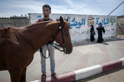 Abdulla al Ghefari waits near Ansar Square in Gaza City, Gaza Strip.