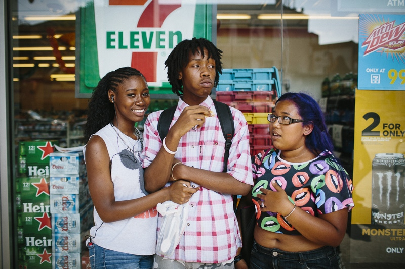 From left, Tiffany, Hannibal and Lavendar hang out near Fulton Mall in Brooklyn, New York after school on September 4, 2014.