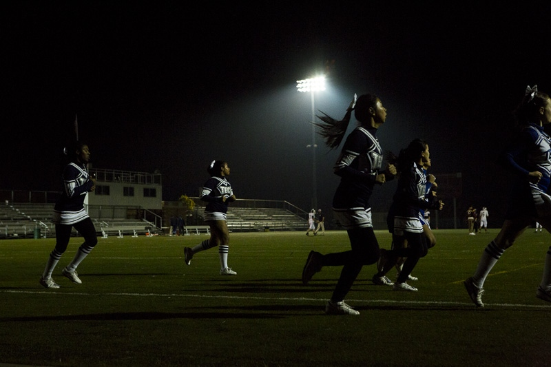 The Brooklyn Cheer team runs a lap before the Brooklyn Tech Engineers play their last game of the season at Aviator Sports Center in Brooklyn on November 5, 2015.