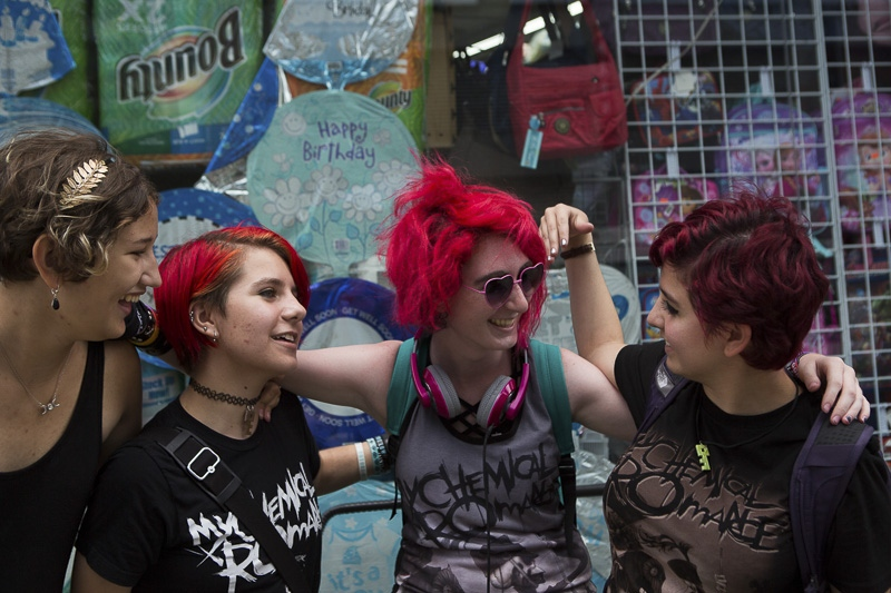 "From left, friends Felicidad, 16, Charles, 16, Izzy, 17, and Sophia, 17, wear matching ""My Chemical Romance"" t-shirts for the first day of school on September 9, 2015."