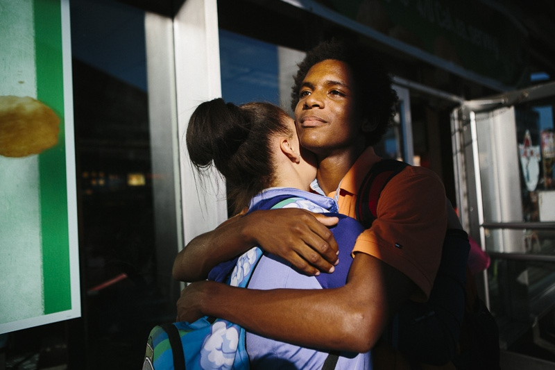 Two friends embrace on their way home after school in front of a McDonalds in Brooklyn on September 17, 2015.