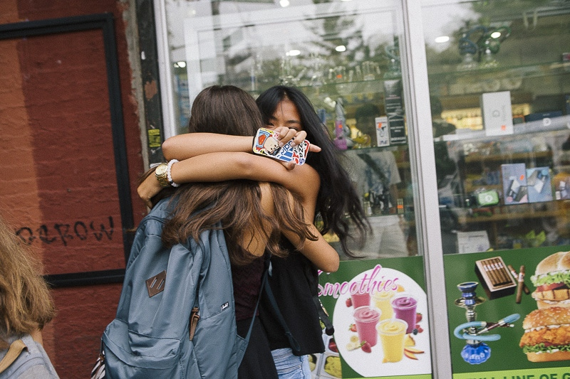 Two friends greet each other on the first day of school in Brooklyn on September 9, 2015.