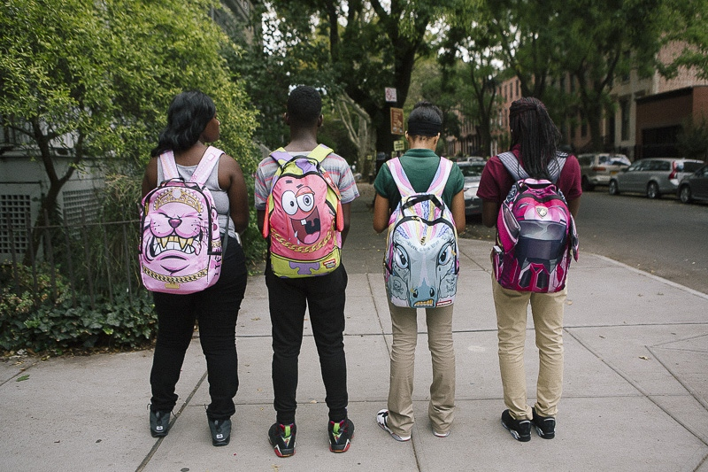 The first day of school in New York City. Kids sport backpacks purchased from Fulton Mall in Brooklyn.