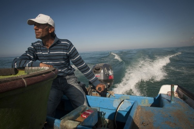 "Abou Yasser steers his 'line' boat at 3 kilometers out from the Gazan coast: ""At 5 kilometers your life is in danger with the constant battle with the Israelis"""