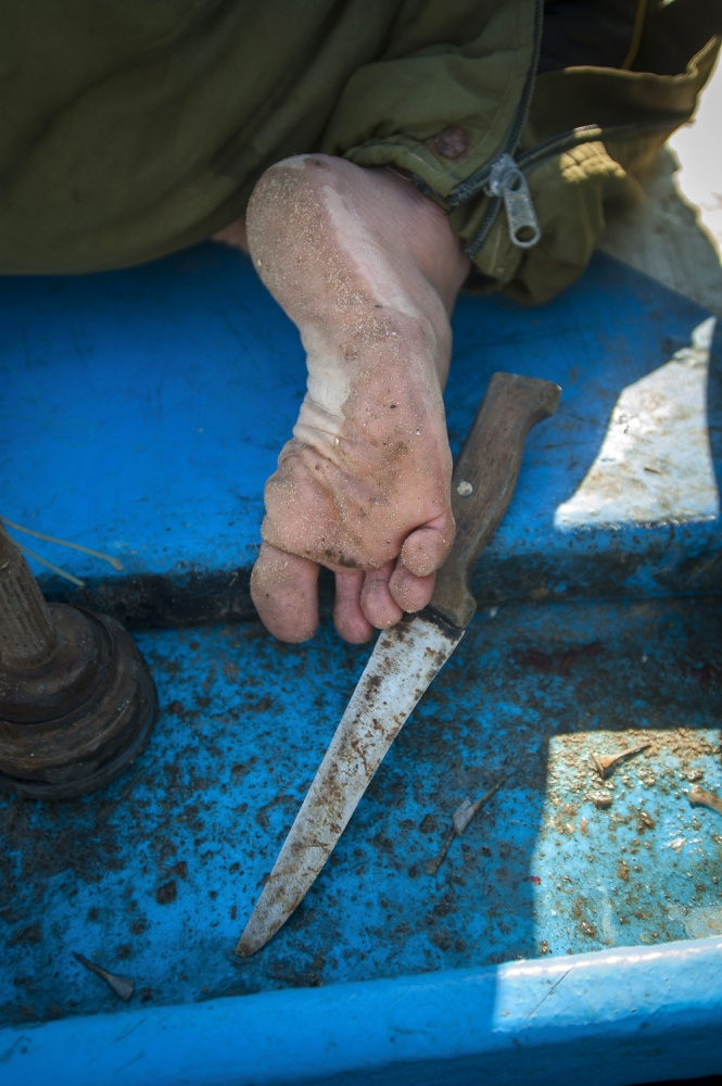 No shoes for more grip on board their line boat for 28 year old Mohamad Miqdad.
