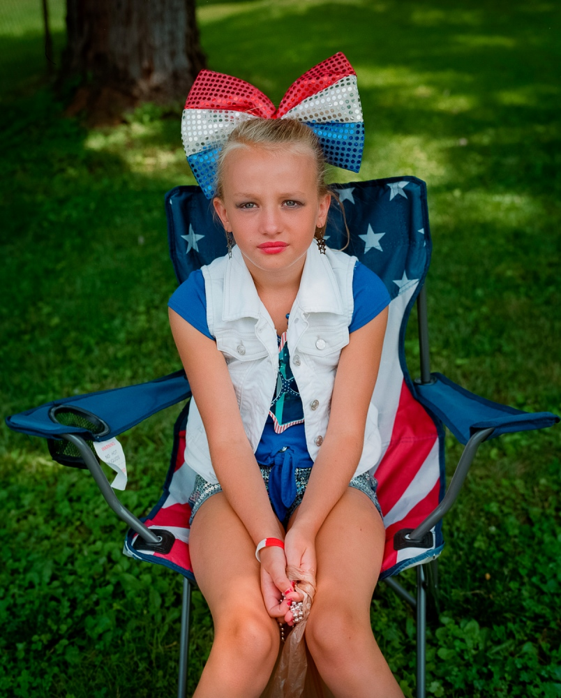 Girl watching the Fourth of July parade, South Shore, KY. Like neighboring Portsmouth, across the Ohio River, the small community of South Shore, Kentucky is currently struggling with a heroin epidemic.