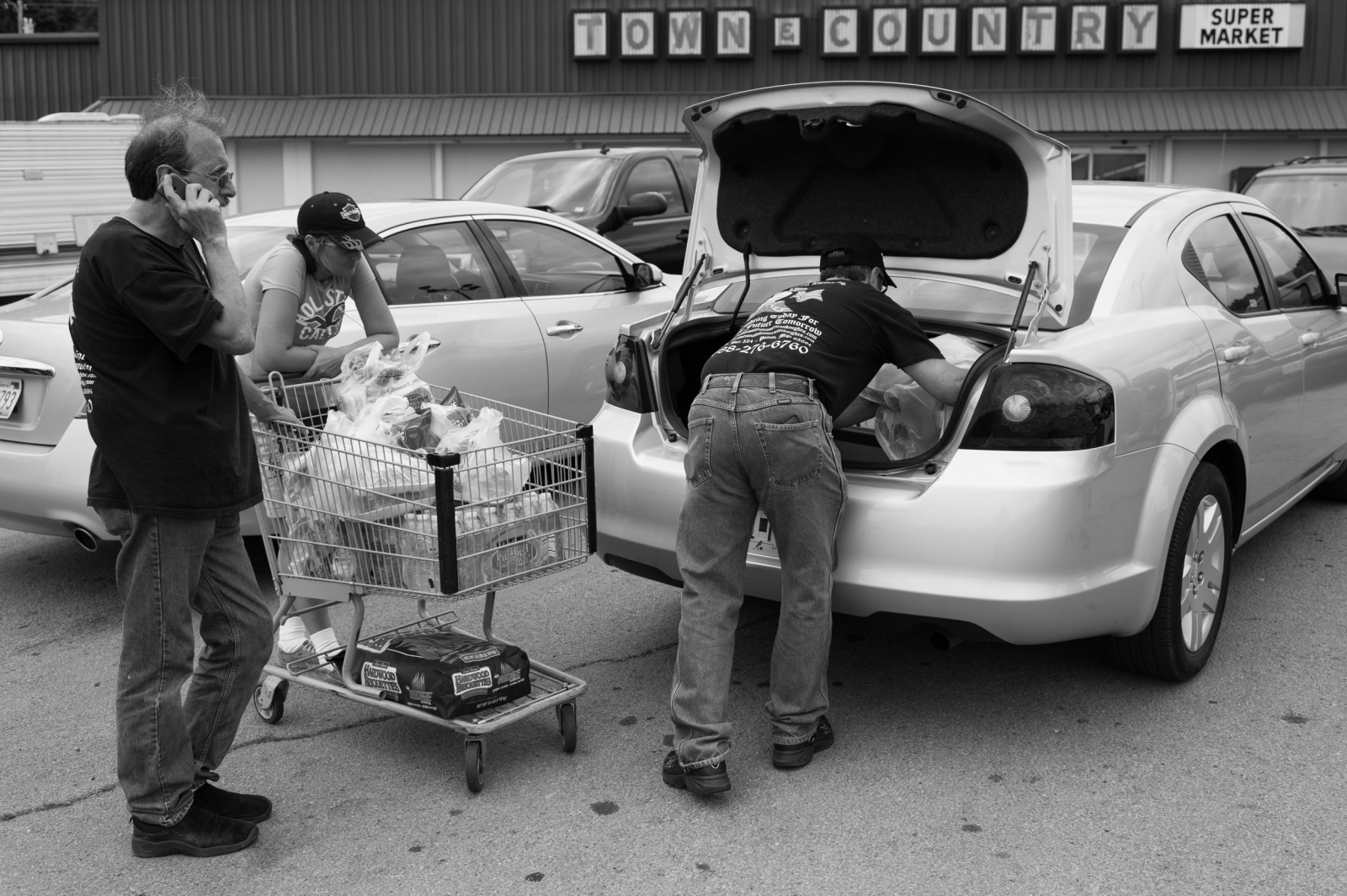 Missouri.AnImperial Wizard of a mid-western based Klan realm, his wife and Imperial officer food shooping prior to a weekend unity gathering.