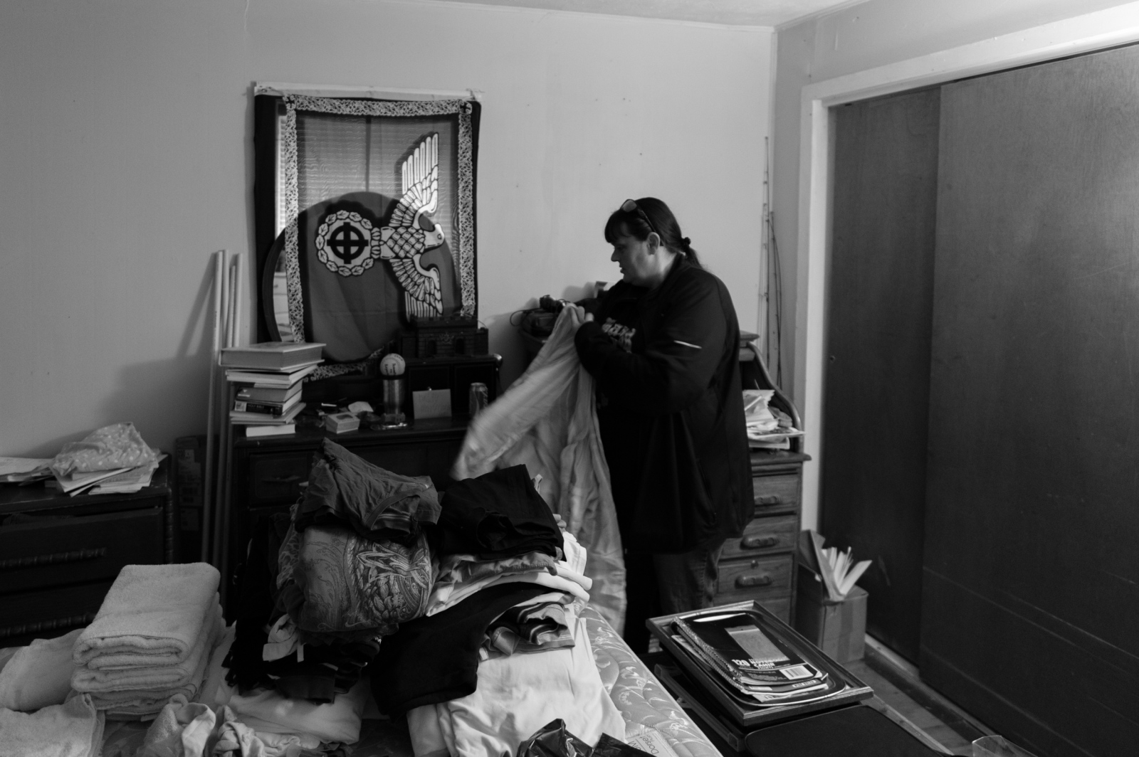 Ohiio.A Klanswoman attempts to get the contents of her home back in order following an FBI raid and search. Authorities were acting on a tip that her husband, the leader of a southern-based Klan realm who was previously arrested on an illegal weapons charge had posed with a firearm in a recent Facebook post (it is unlawful for a convicted felon to be in contact with a firearm). The couple believes that the reason for the raid was exaggerated and the actual intent was to commandeer a list of their members. The firearm was legally registered to his wife.