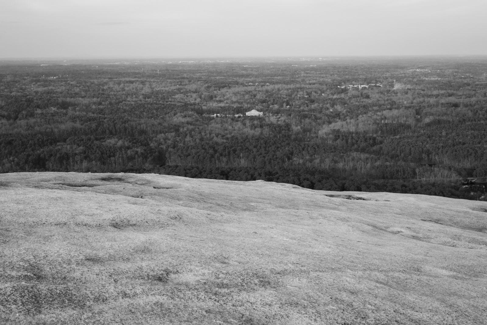 """Stone Mountain, GA. In 1915, William J. Simmons, a former Methodist preacher, launched a campaign to reestablish a new era of the Ku Klux Klan. Inspired by the film """"The Birth of a Nation,"""" Simmons led a small group to the summit of Stone Mountain to set a cross ablaze in advance of the film's debut. At the time of the Klan's resurgence, Stone Mountain was owned by Samuel Venable, who was a quarry operator. Mr. Venable was a fan of """"The Birth of a Nation,"""" and accompanied Simmons on that November night to become an active member of the Klan, hosting regular ceremonies on the mountain."""