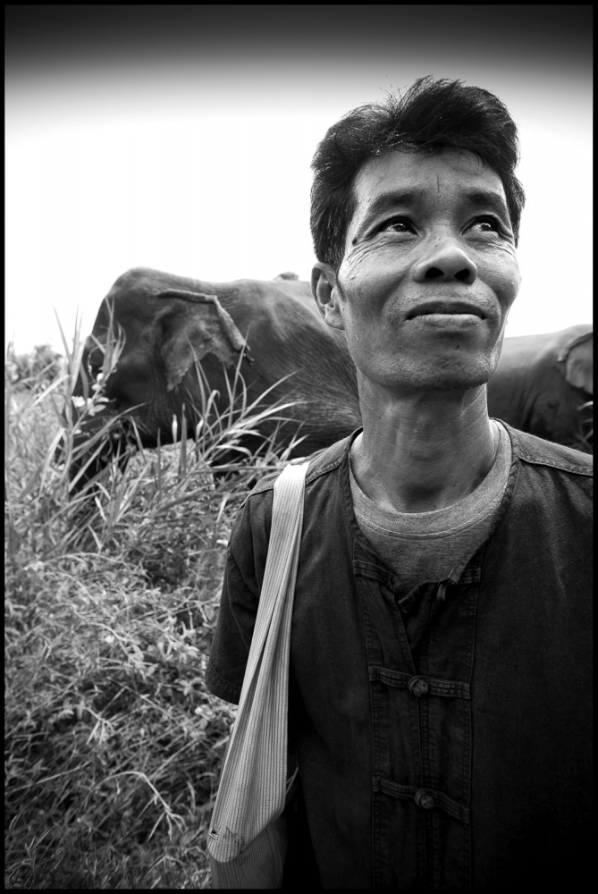 "Sot with Somai at Boon Lotts Elephant Sanctuary, Baan Na Ton Jan, Tambon Baan Tuck, Si Satchanalai, Sukhothai, Thailand. Sot: "" I didnt think what Katherine was trying to do here was possible when i first came to BLES. Working with elephants without the hook or the chains. Now i have to admit i was wrong."" Sot is one of a handfull of Mahouts at BLES leading the way in Elephant Welfare."