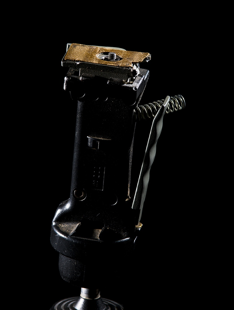 I bought this tripod head in the early 1990s. It's been a workhorse. Over the years I bought multiple quick-release plates so I could change cameras quickly. I kept losing the replacement plates but I never lost the original. I really liked the cork pad.