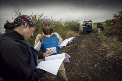 HALO programme Manager Helen Gray checking paperwork at Damo minefield with Supervisor Arcillia Adriano. Maputo Province, Mozambique.