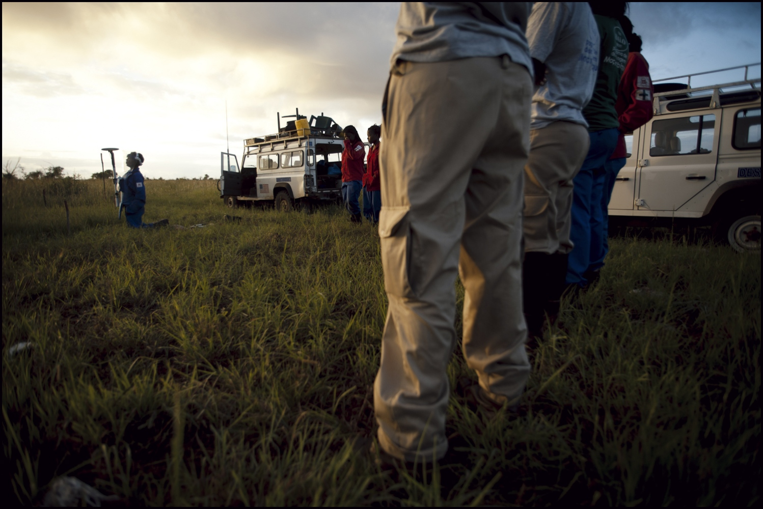 "Each morning the deminers run through their drill in a ""dummy"" minefield. It reminds each section that Standard Operating Procedures are essential for safety. 6am at""Damo"" minefield, Maputo Province, Mozambique."