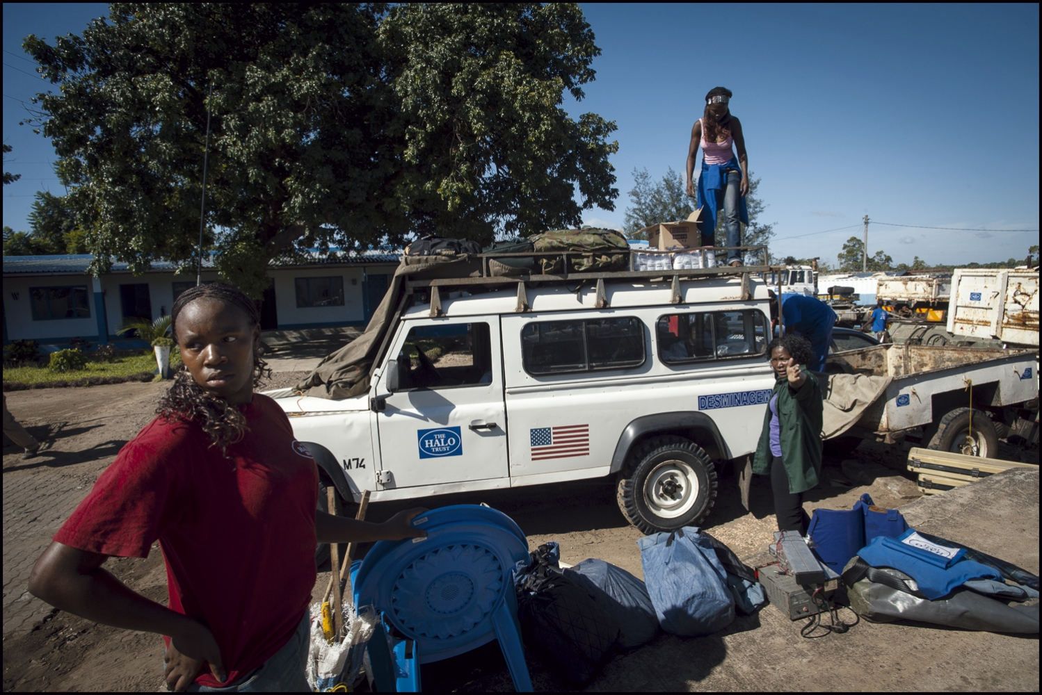 Deployment day at the HALO head quarters compound in Zimpeto, Maputo, Mozambique. L-R Women section De Miners Amelia Zulmira (21), Helena Wetela (28) and Luisa Chelene (29) load up their landrover before travelling to Damo camp.