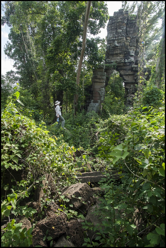 Hidden in the Jungle and still requiring a local guide to find a lone tourist visits Ta Nem Temple at Banteay Chhmar in Cambodia. Built in the 12th century by Khmer King Jayavarman 7th (1181-1219).