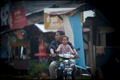 This youngster with her father riding through Banteay Chhmar in Cambodia hopefully will benefit from the temple preservation and UNESCO World Heritage status (if it comes) Plus the tourist income it will bring to the area.