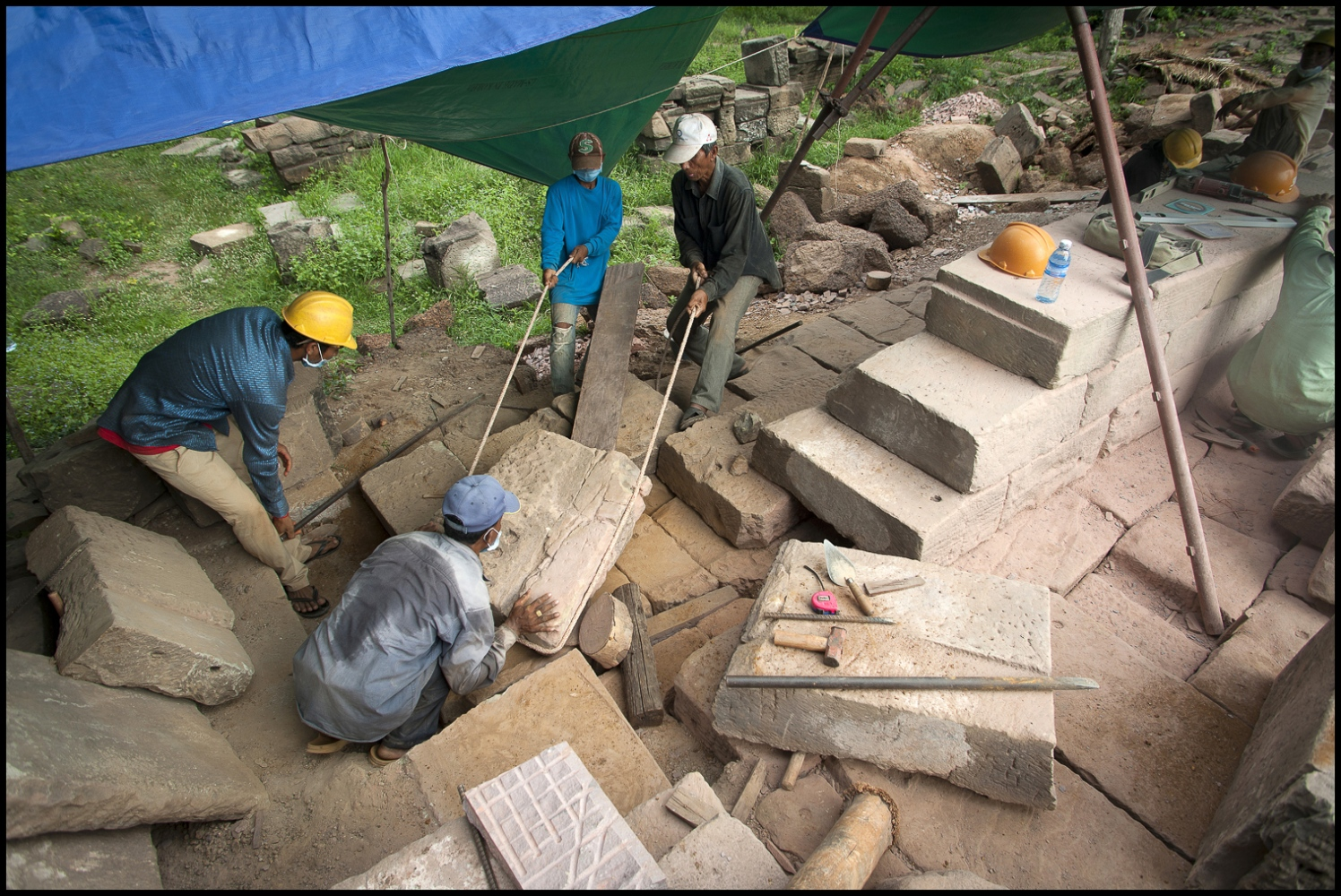 Khmer stone masons replacing the stone work to the Banteay Chhmar Temple in Cambodia. Built by Khmer King Jayavarman 7th (1181-1219). they have spent the last 3 years painstakingly dismatling and rebuilding this 20 metre section of the temple ruins at Banteay Chhmar.