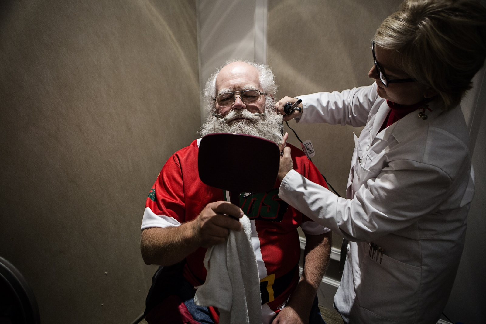 "Beard styling is an essential Santa skill. Some use glitter spray to make their beards ""frosty."""