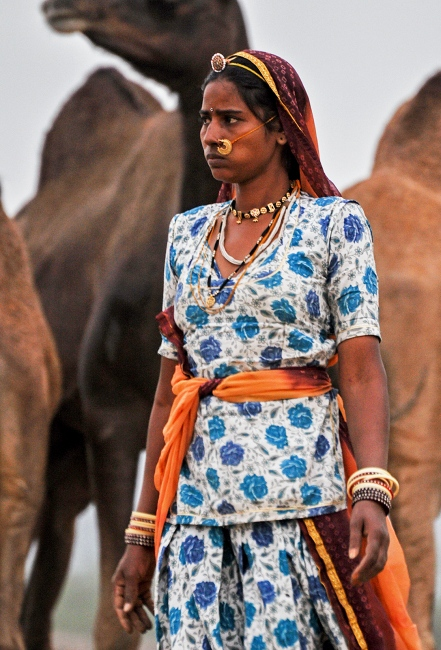 The song of the desert. A gypsy sings a hauntingly beautiful tune while the train speeds through the Thar desert.