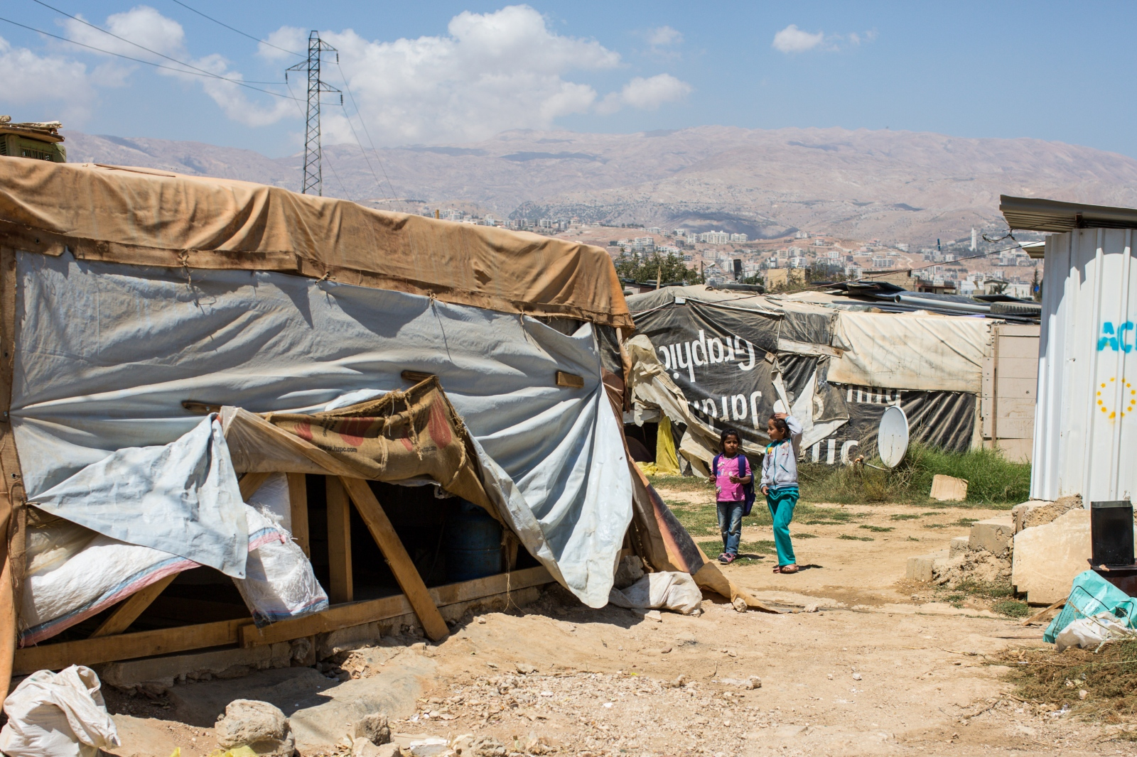 Bekaa Valley, LEBANON, September 5, 2014: Children walk through an informal settlement for Syrian refugees in Lebanon's Bekaa Valley. UNICEF reports that 6.5 million Syrian children have been affected by the Syrian war. 2.8 million children are no longer in school and more than one million are living as refugees in neighboring countries.
