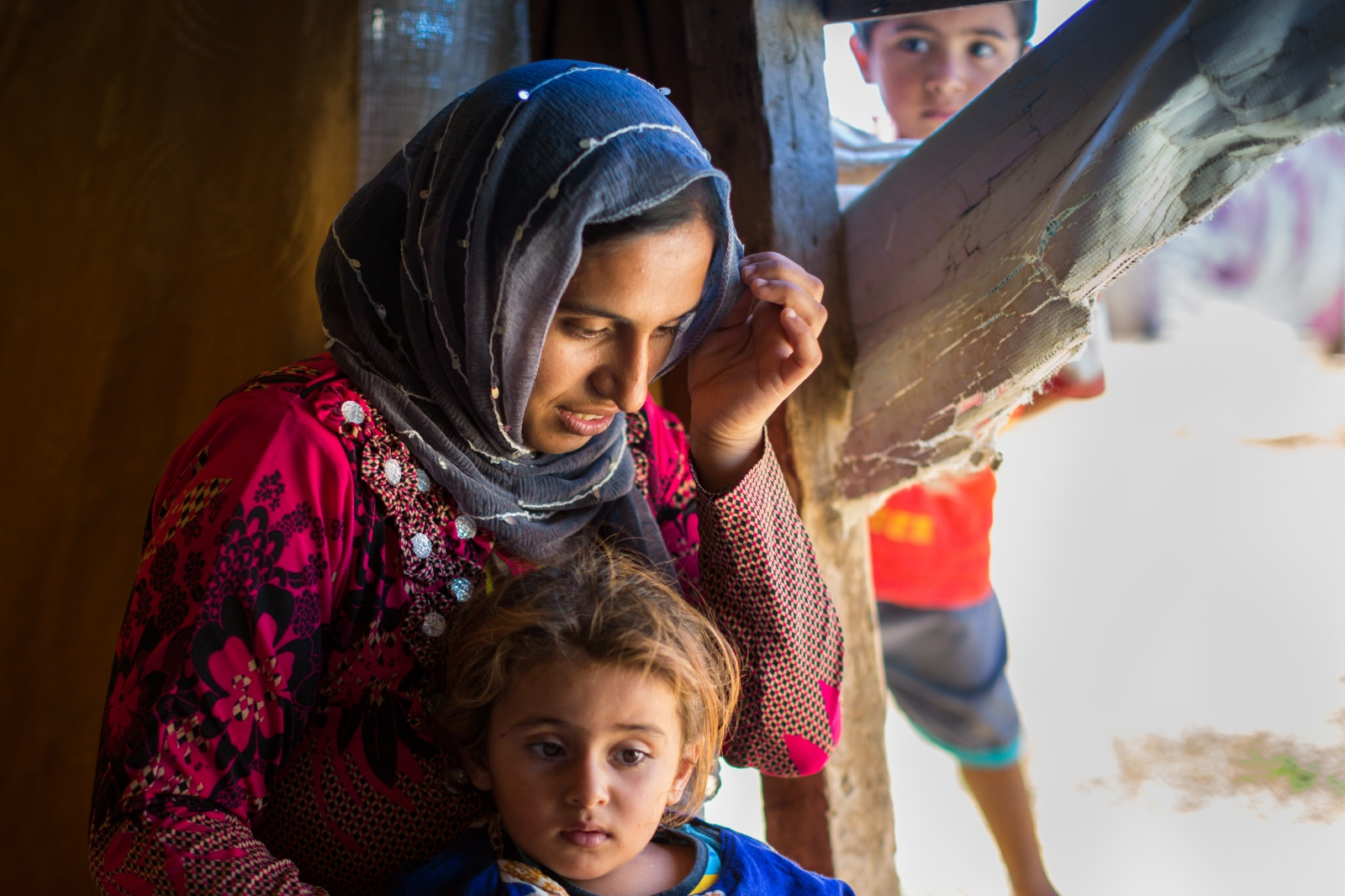 Bekaa Valley, LEBANON, September 5, 2014: Fadile (35) is mother of eight children; six girls and two boys. Most of the refugees living in Lebanon's makeshift shelters are women and children.