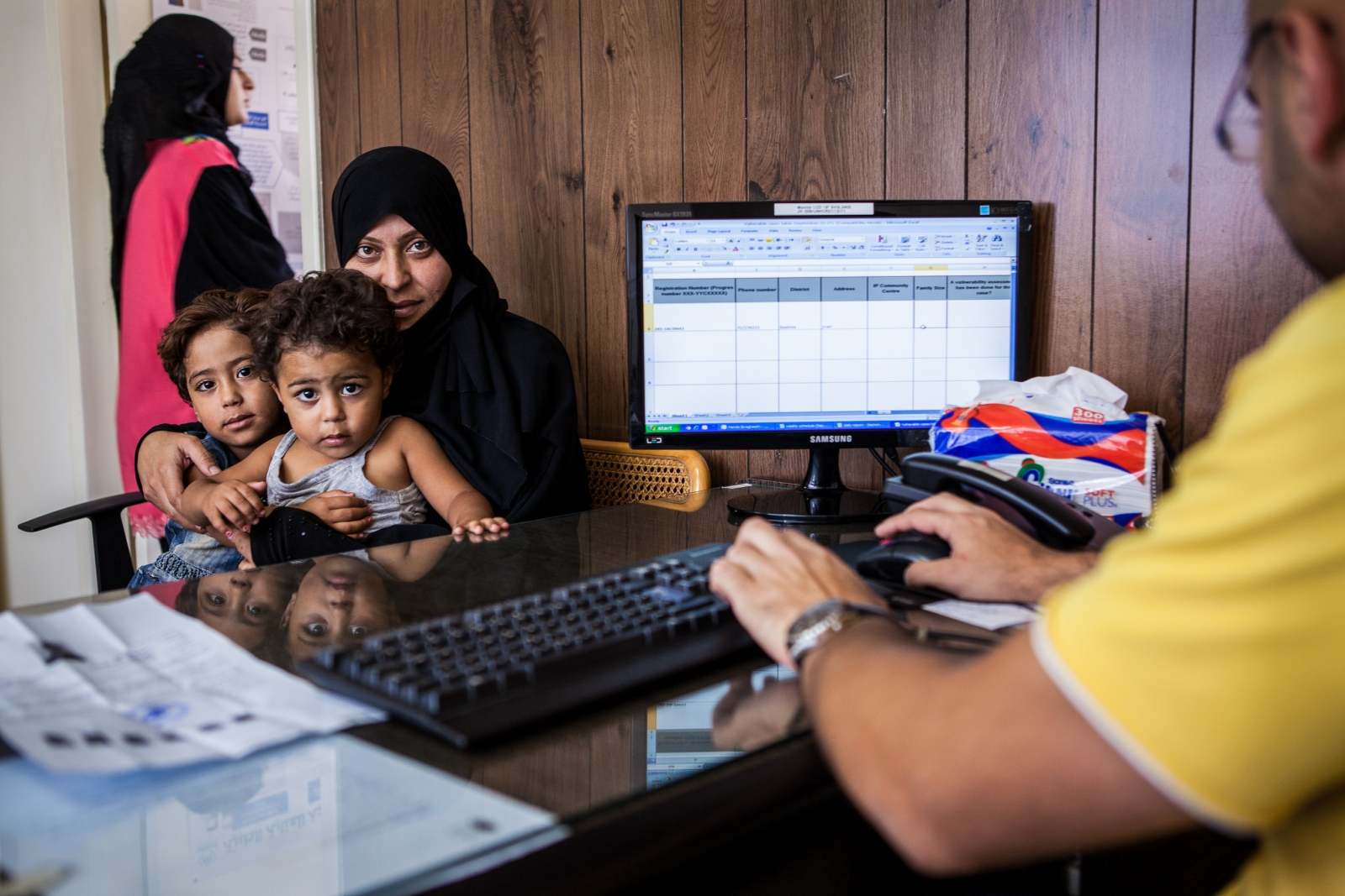 Beirut, LEBANON, September 22, 2014: Alissa Amad Mohammad Ali (35) and her children, Rona (4), and Amal (2) are receiving an vulnerability assessment at Makhzouni Foundation who collaborated with UNHCR. Alissa has six children and is a single parent since her husband went missing in Syria two years ago.