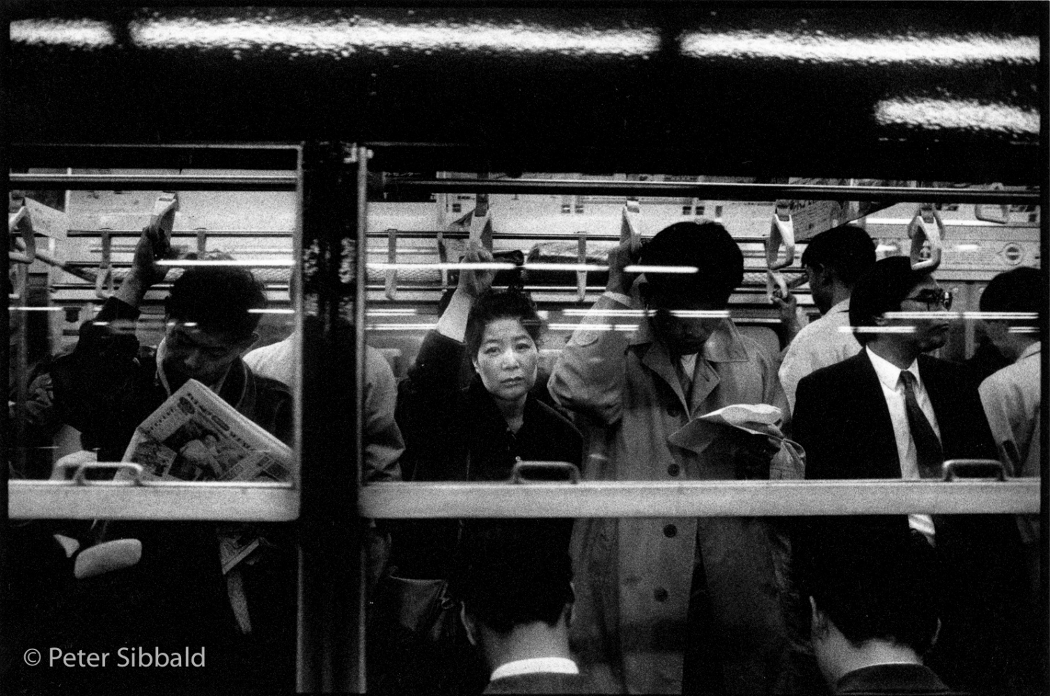 Art and Documentary Photography - Loading 004-woman_on_train.jpg