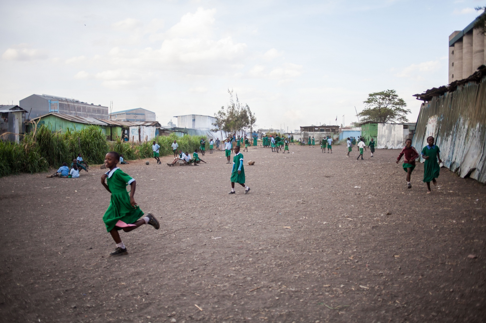 Sinai Slum, Nairobi, KENYA, October 29, 2013: School children play during a break at Jobenpha Community school. Some ex pupils made it to university, showing the kids that there is a way for them to make it out of the slums through education.