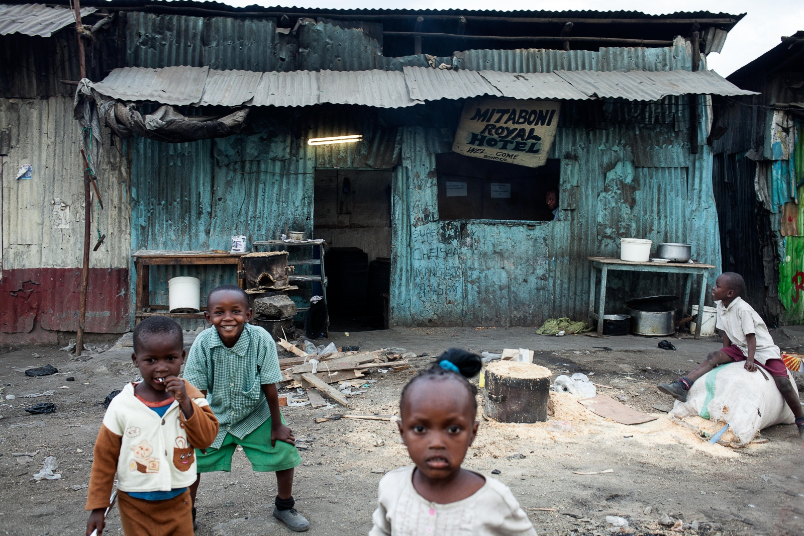 Sinai Slum, Nairobi, KENYA, October 29, 2013: Children play in front of a hotel. Many children from Nairobi's townships do not attend school.