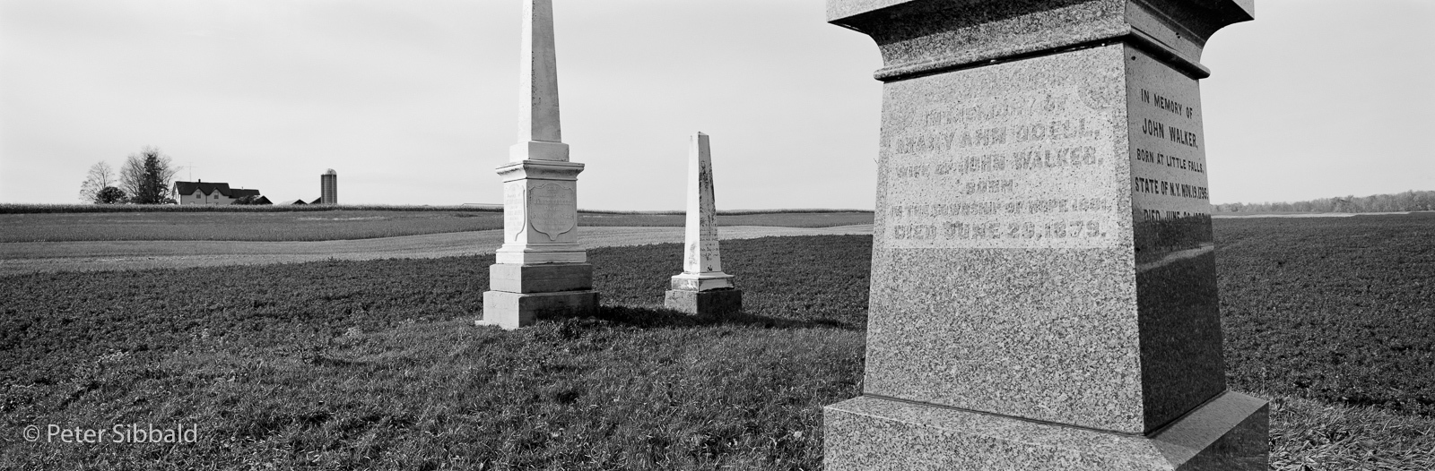 "Welcome, Hope Township, Northumberland County, Ontario. Approximately 43°58'11.24″N 78°21'39.06″W, facing Northwest, circa November 3, 2005 The pioneer cemetery of the United Empire Loyalist family of John Walker lies on the edge of a farm field in what the Neptis Foundation calls the ""Unprotected Countryside"", land that is immediately outside Ontario's Greenbelt and at greater risk of development pressure due to leapfrogging. In Ontario's past, pioneer graves have been frequently disinterred and consolidated in other locations disassociating history from its place."