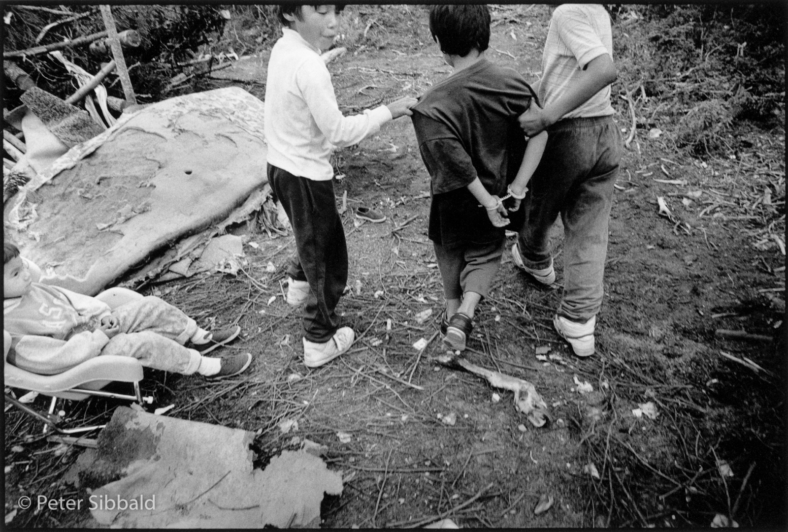 Art and Documentary Photography - Loading 012-boy_in_handcuffs_led_away.jpg