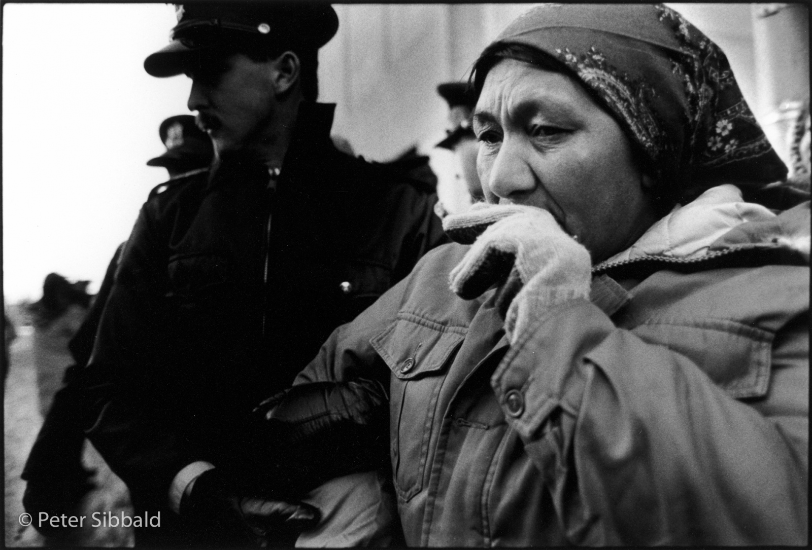 Ottawa, Canada. The Nation's Capital Three days after her three month walk, Elizabeth Penashue is arrested for blocking employee access to the Department of National Defence Headquarters during a Remembrance Day civil disobedience action protesting low-level flight training over Nitassinan. Copyright Peter Sibbald, 1990.