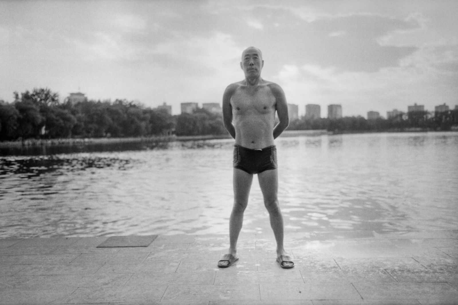 A man landed after swimming in the lake in Yuyuantan park. He offered me to shake hands with a big smile when he noticed that I was Japanese.  Beijing, China. 2015