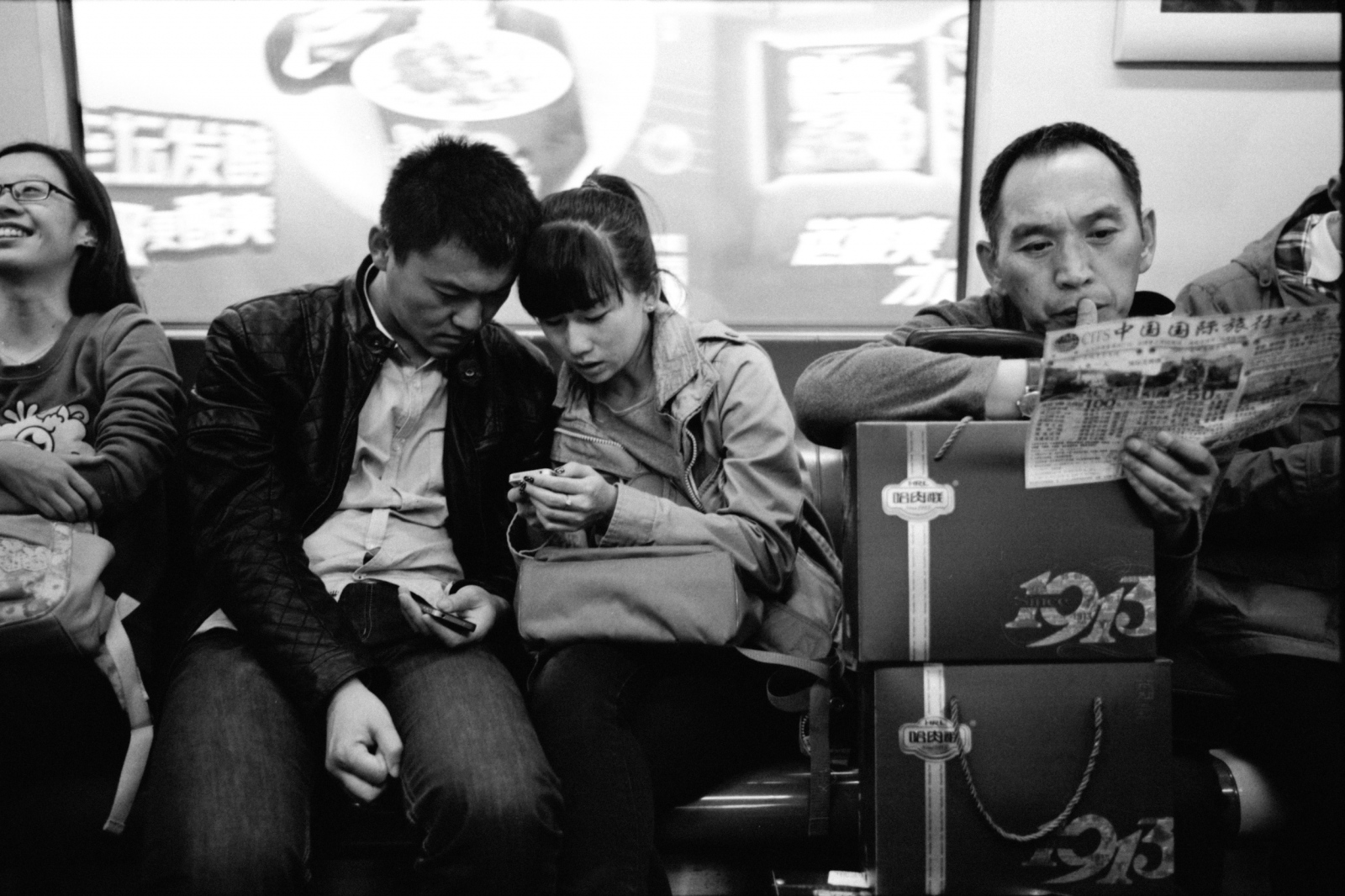 Lovers on a subway. Beijing, China. 2015