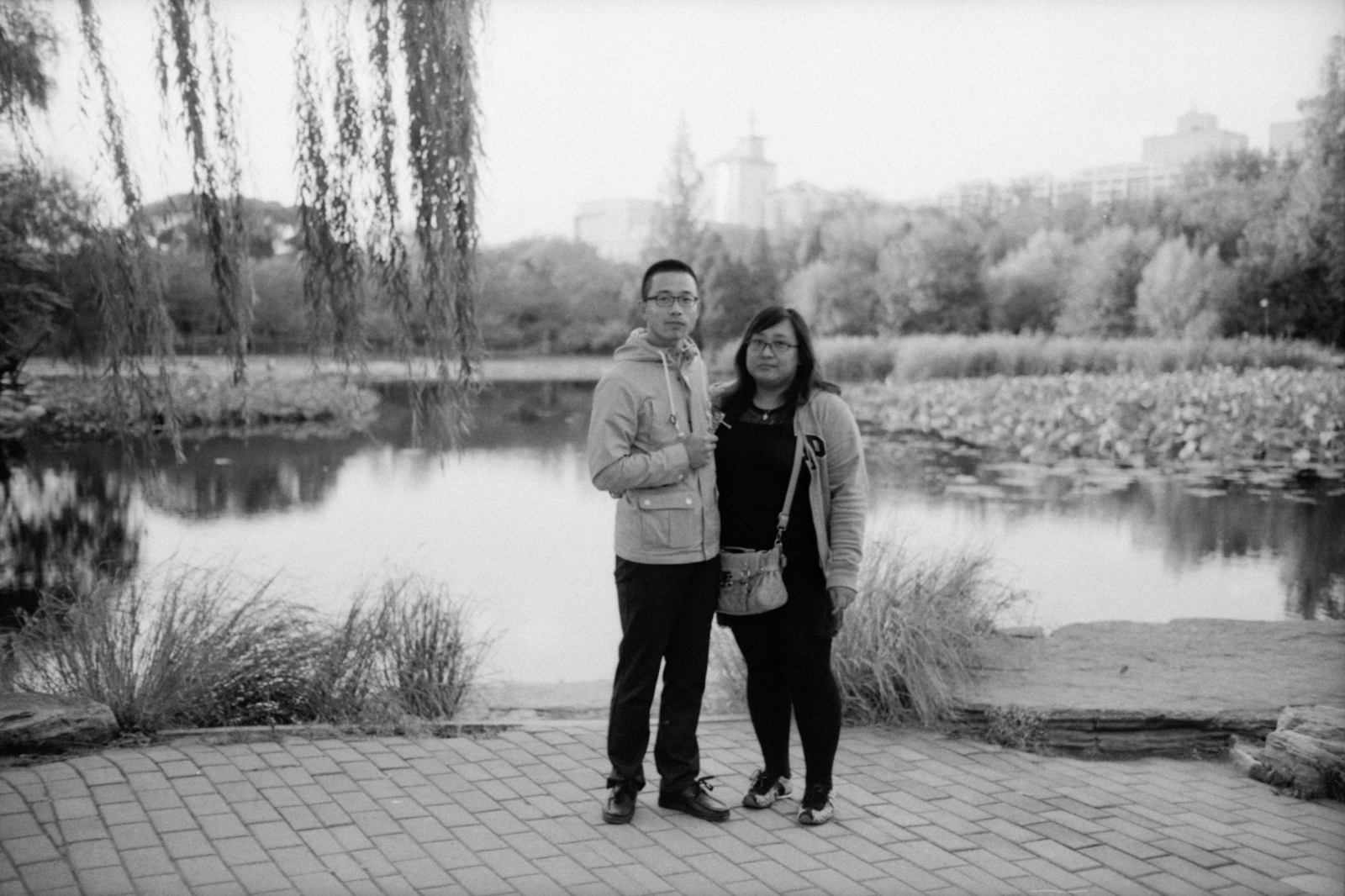 A couple taking a walk in Yuyuantan park. Beijing, China. 2015