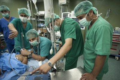 Anaesthetist at work with fellow surgeons, nurses and doctors at the Al Shifa Hospital, Gaza city, occupied Palestinian territory.