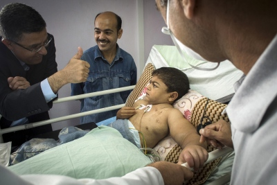 Dr Abdul Hammad gives a thumbs up to 9 year old patient Abdel Motalib Awad following his successful surgery in the Al Shifa Hospital.