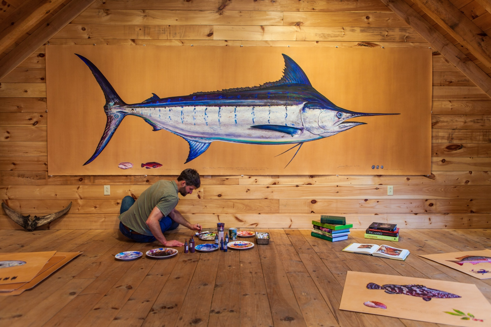 Artist James Prosek in his studio, painting ocean fish lifesized from life. From a cover story for Nature Conservancy Magazine.